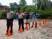 Natalia with other staff at the refuge during an archery program.