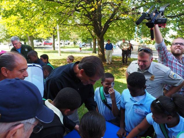 U.S. Fish and Wildlife Service Director Dan Ashe demonstrating how to tag a monarch to students