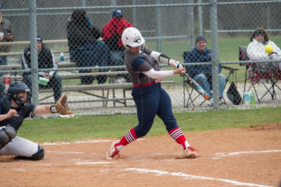 Junior+pitcher%2Finfielder+Haley+Hodges+steps+into+her+swing+during+the+team%E2%80%99s+double+header+against+the+University+of+Illinois-Springfield+March+25.+Hodges+recently+became+the+softball+player+with+the+most+single-season+home+runs+in+USI+history.