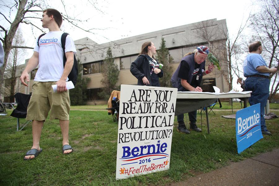 Students and volunteers ask passersby if they have registered to vote during a Bernie Sanders rally Thursday in the Free Speech Zone. Although the group was told they were not allowed to do voter registration by the Dean of Students Office, the volunteers still handed out information about where and how to register.