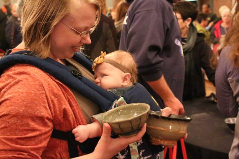 "USI alumna, Katie Ewers searches for the perfect ""cereal bowl"" with her daughter Samantha at Empty Bowls Saturday morning. Ewers said she took Al Holen's ceramics class last summer and said she would love to do pottery again. ""It was a fun class,"" Ewers said."