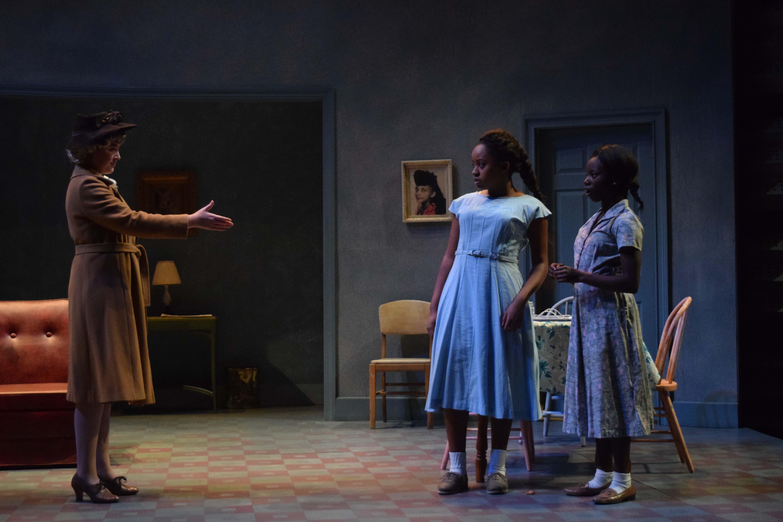 Ernestine Crump (freshman Jesmelia Williams) and Ermina Crump (freshman Jada Alexia Hampton) are hesitant to shake Gerte Schulte's (junior Hannah Michelle) hand.