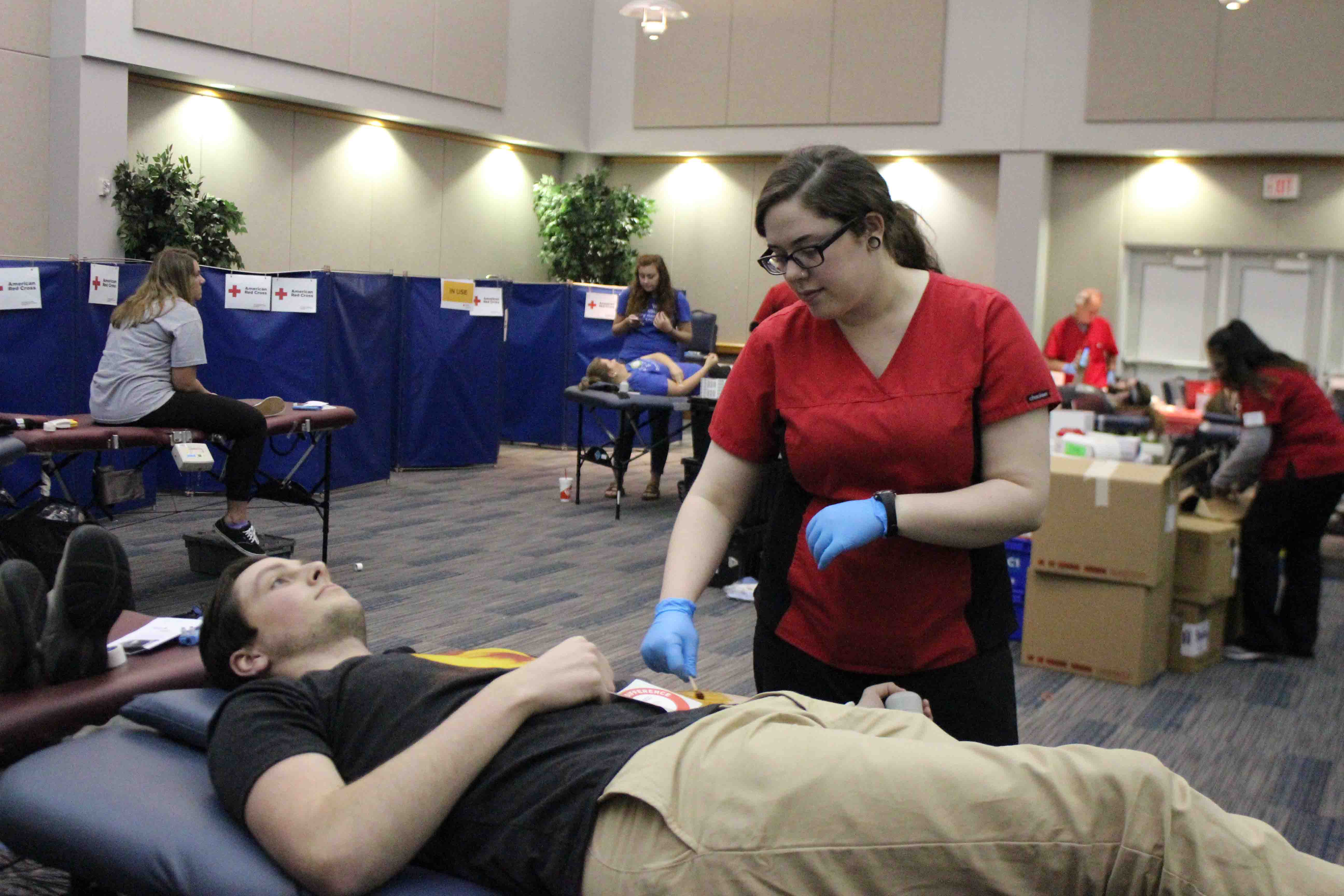 Ethan Ducheon, a sophomore biology major, gives back to his community by donating blood to the Red Cross Foundation on March 21st.