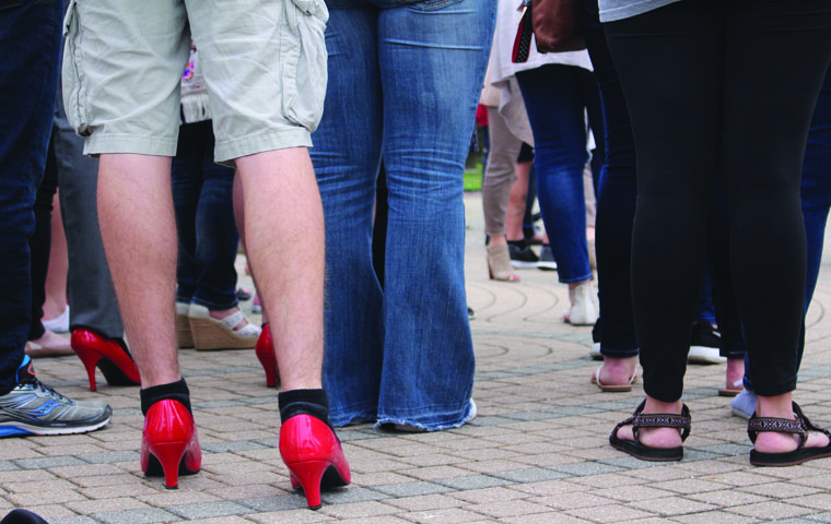 After+speeches+about+sexual+assualt+and+gender+violence%2C+male+audience+members+walked+a+mile+in+bright+red+high-heels+to+raise+awareness+for+violence+against+women+and+men+during+the+11th+annual+%E2%80%9CWalk+a+Mile+in+Her+Shoes%E2%80%9D+Tuesday+evening.+Students%2C+professors+and+community+members+walked+from+the+UC%2C+past+the+Orr+Center+and+ended+at+the+College+of+Liberal+Arts%2C+where+members+of+the+community%2C+officers+and+Dean+Beeby+spoke+about+their+experience+walking+in+the+heels%2C+before+the+participants+took+a+pledge+to+never+%E2%80%9Ccommit%2C+condone+or+remain+silent+about+violence+against+women.%E2%80%9D%0A