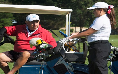 Golf scramble honors coach