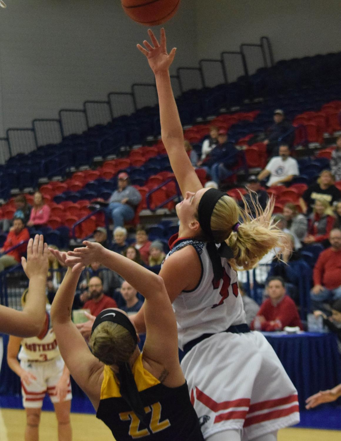 Kaydie+Grooms%2C+senior+forward%2C+goes+up+for+a+reverse+layup.