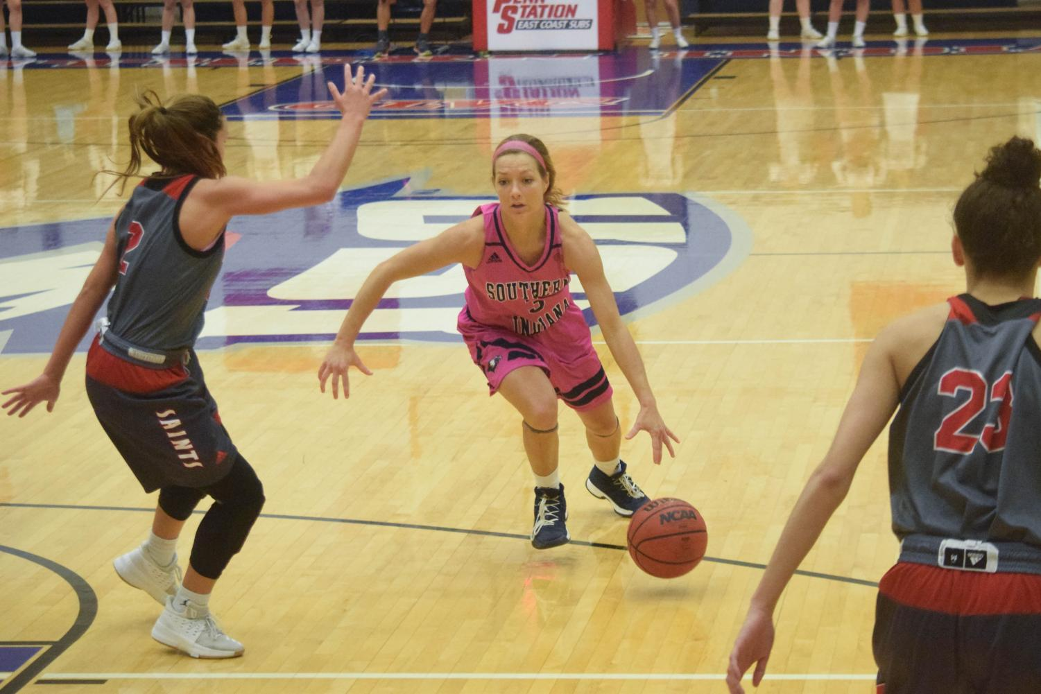 Randa+Harshbarger%2C+senior+guard%2C+attacks+the+basket+against+a+Maryville+player+Thursday+night+at+the+PAC.