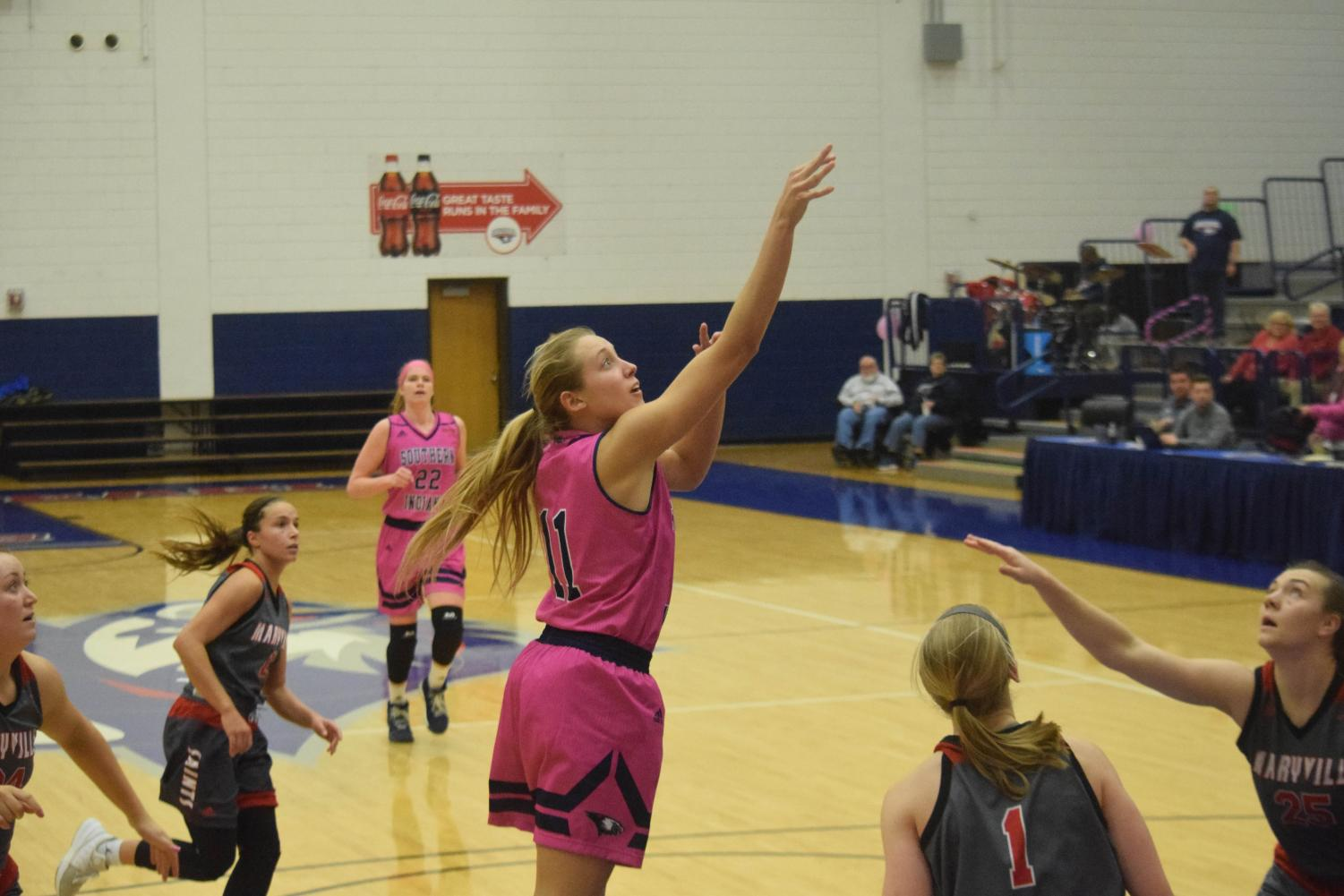 Morgan+Sherwood%2C+sophomore+guard%2C+goes+up+for+a+shot+Thursday+night.