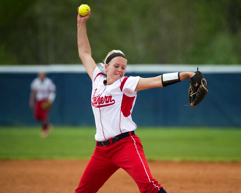 Pitcher Brooke Harmening winds up for a pitch during a game in 2015. Harmening is now a graduate assistant for the softball team while working toward her master's in sports management.