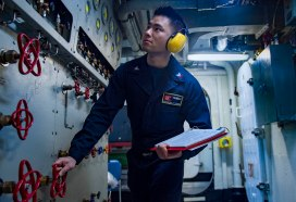 160102-N-NX690-007 ARABIAN GULF (Jan. 2, 2016) Machinist's Mate 2nd Class B. Njoo adjusts refrigeration controls to produce liquid oxygen aboard aircraft carrier USS Harry S. Truman (CVN 75). Harry S. Truman Carrier Strike Group is deployed in support of Operation Inherent Resolve, maritime security operations, and theater security cooperation efforts in the U.S. 5th Fleet area of operations. (U.S. Navy photo by Mass Communication Specialist 3rd Class J. M. Tolbert/Released)