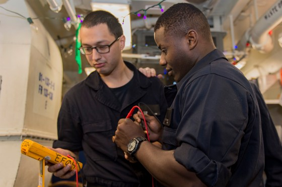 160102-N-NX690-012 ARABIAN GULF (Jan. 2, 2016) Electrician's Mate Fireman N. Williams, right, and Electrician's Mate Fireman J. Reyna use a multimeter to test a fuse aboard aircraft carrier USS Harry S. Truman (CVN 75). Harry S. Truman Carrier Strike Group is deployed in support of Operation Inherent Resolve, maritime security operations, and theater security cooperation efforts in the U.S. 5th Fleet area of operations. (U.S. Navy photo by Mass Communication Specialist 3rd Class J. M. Tolbert/Released)