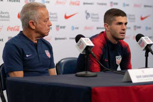 USMNT coach Dave Sarachan and Christian Pulisic at a press conference.