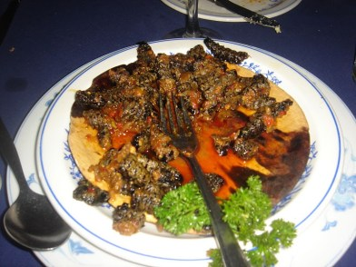 a dish of mopane worms - a fave from Zimbabwe