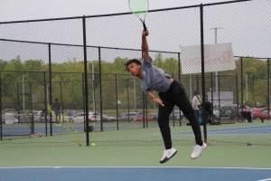 Junior Playing tennis