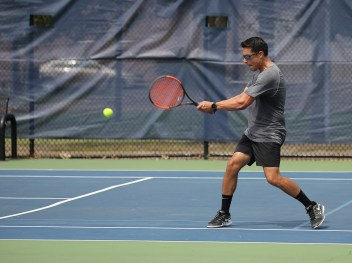 USTA Mid-Atlantic's Summer Guide to Tennis - player returning a forhand