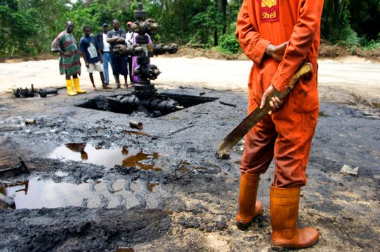 Workers subcontracted by Shell Oil Company clean up an oil spill from an abandoned Shell Petroleum Development Company well in Oloibiri, Niger Delta. Wellhead 14 was closed in 1977 but has been leaking for years, and in June of 2004 it finally released an oil spill of over 20,000 barrels of crude oil.