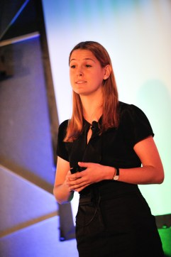 Hollie Gordon, founder of Milaana, pitches on stage