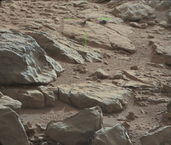 Green lines point to a shiny protuberance on rock imaged by the Curiosity rover on Mars. Credit: NASA/JPL/Malin Space Science Systems. Image processing 2di7 & titanio44 on Flickr.