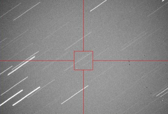 A newly found asteroid, 2013 EC can be seen in the lower left corner of the red box in this image. Screen capture from Virtual Telescope webcast on 3/3/2013.