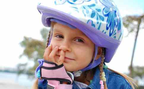 smiling-child-wearing-protective-helmet[1]