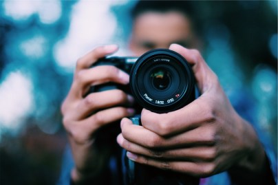 An image of a man taking a photo with a camera