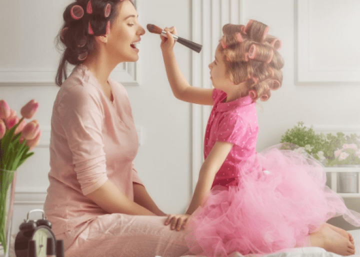 Mom and daughter playing with makeup
