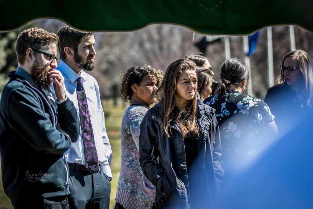 sad friend Wasatch lawn salt lake city cemetery photography for funerals Ryan hender films