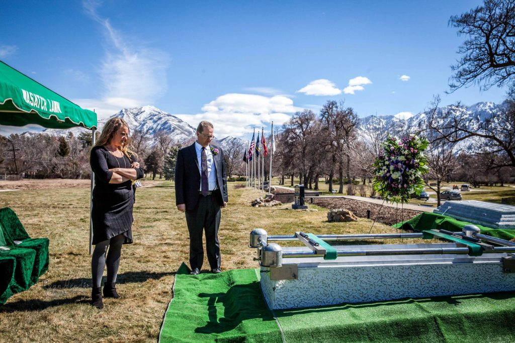 uncle next to casket Wasatch lawn salt lake city cemetery photography for funerals Ryan hender films