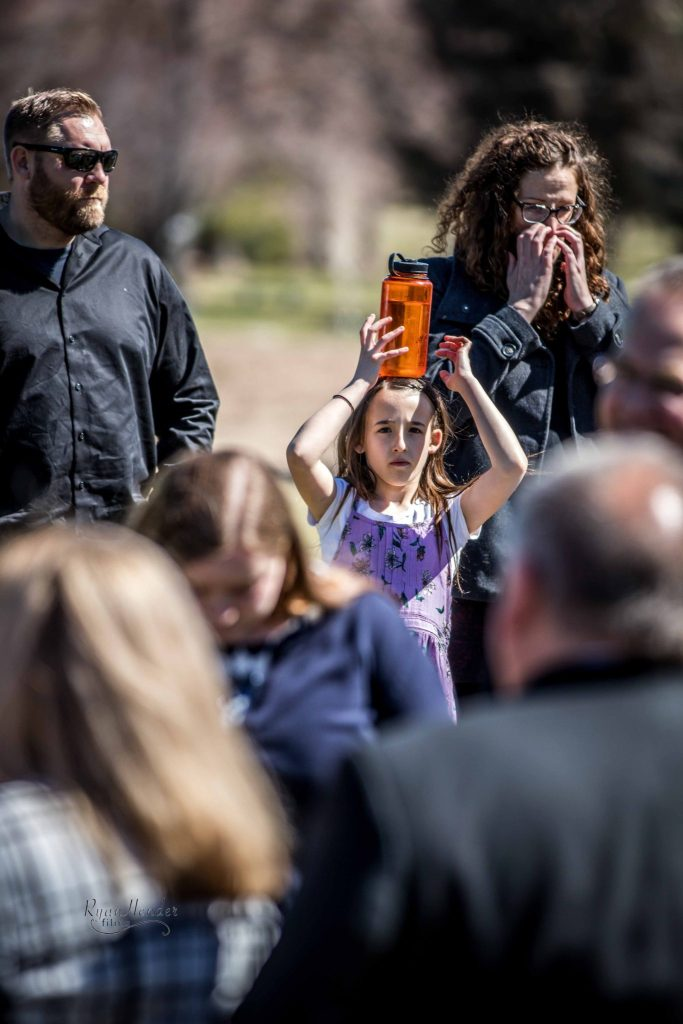 silly girl at funeral Wasatch lawn salt lake city cemetery photography for funerals Ryan hender films