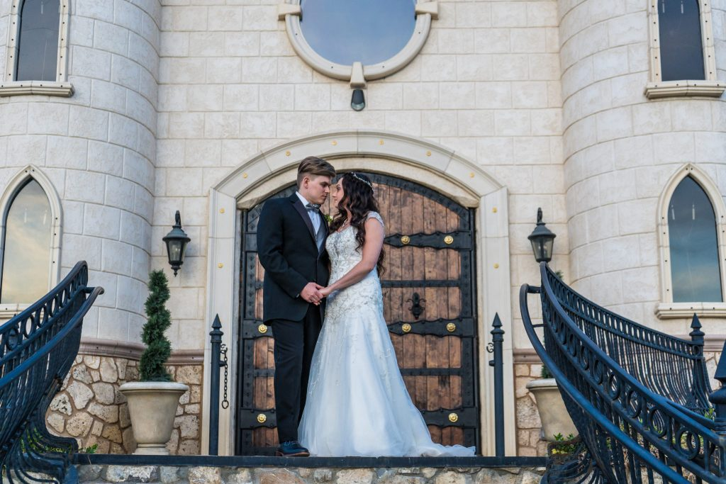 bride and groom on steps at wadley farms wedding venue utah wedding photography