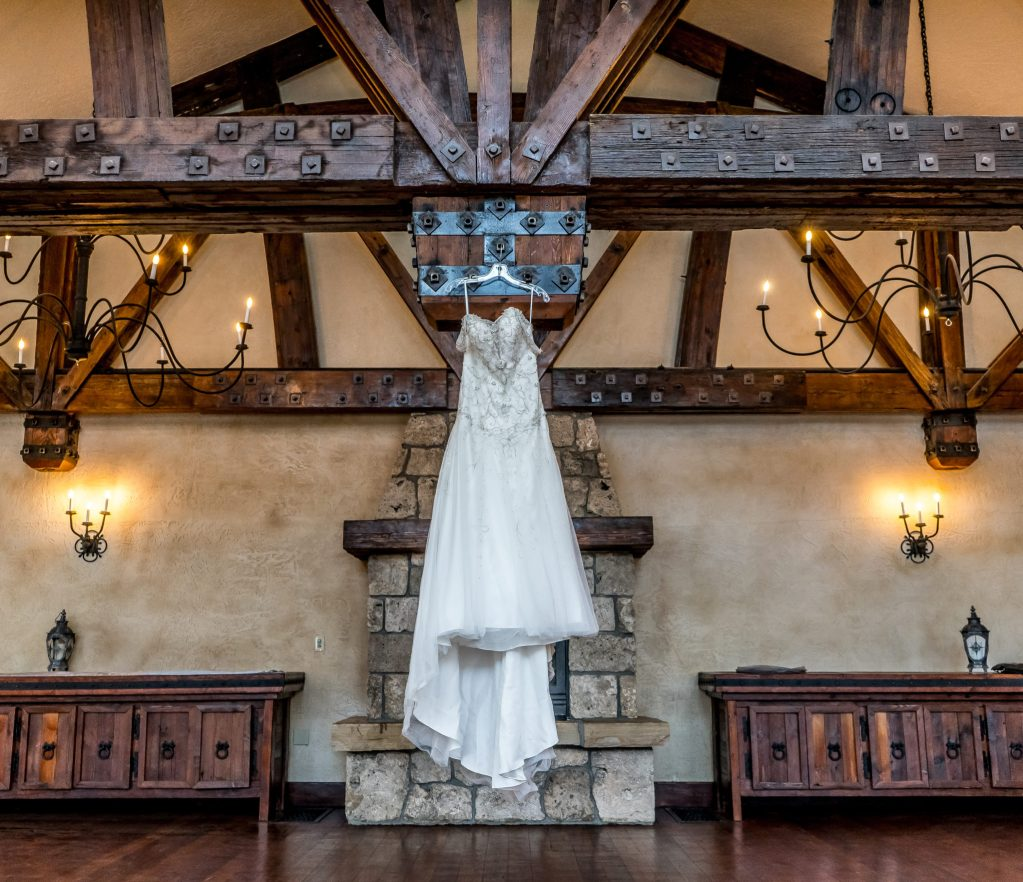 wedding dress hanging in castle