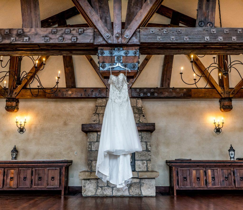 wedding dress hanging in castle