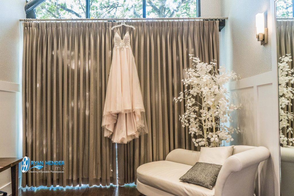 wedding dress hanging on drapes