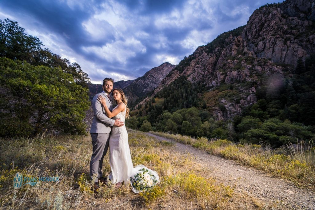 bride and groom in mountains photo shoot