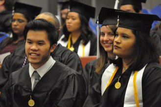 Students wait for the start of the College of Liberal Arts' December 2014 commencement Friday, Dec. 12, at the College Park Center. (Photo by James Dunning/COLA Communications)