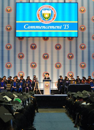 Associate Dean Elisabeth Cawthon speaks Friday, May 15, during the College of Liberal Arts' Spring 2015 Commencement at College Park Center. (Photo by James Dunning/COLA Communications)