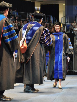 English doctoral graduate Dana Brewer was the first student to walk across the stage Friday, May 15, at the College of Liberal Arts' Spring 2015 Commencement at College Park Center. (Photo by James Dunning/COLA Communications)