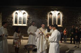 The lighting of the Paschal candle outside the church