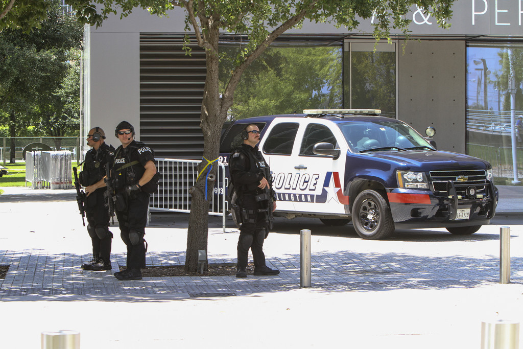 Arlington Police monitor the perimeter of the venue on July 12 where an interfaith tribute was held for the five officers who died in the line of duty last Thursday.