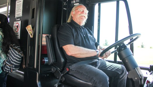 Oldest driver helps settle int'l students