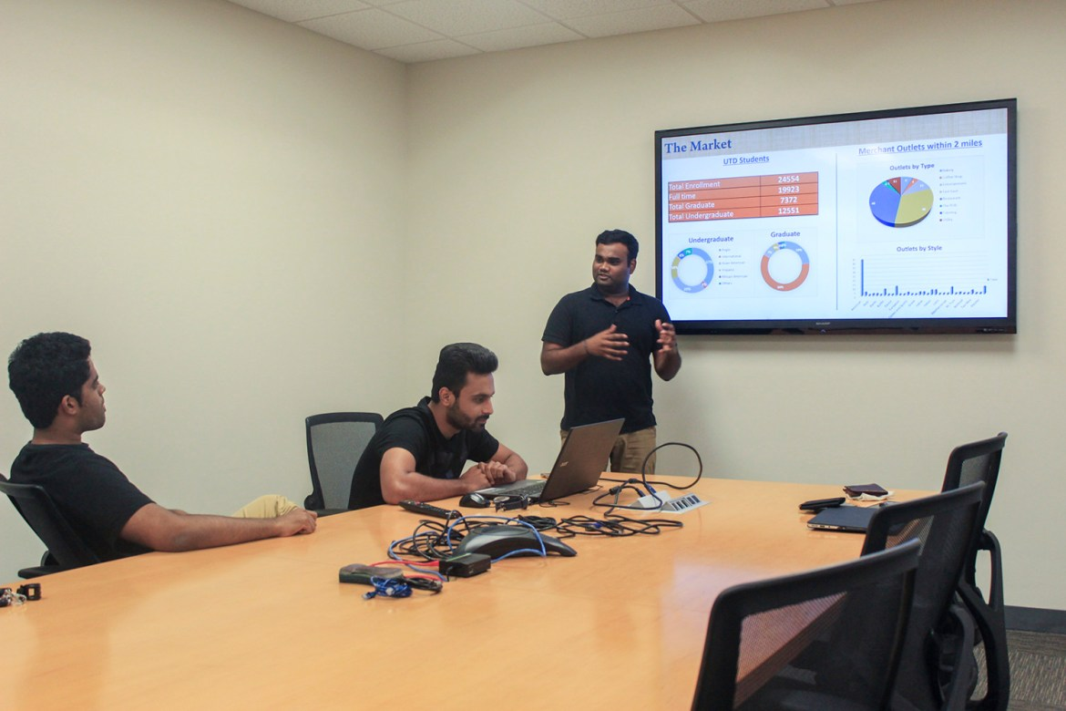 Sanjay Kurani (center), a supply chain management graduate student, said the UNIBEES team hopes to expand the app's user base to universities across Texas by December 2017. Photo by Ankith Averineni   Mercury Staff.