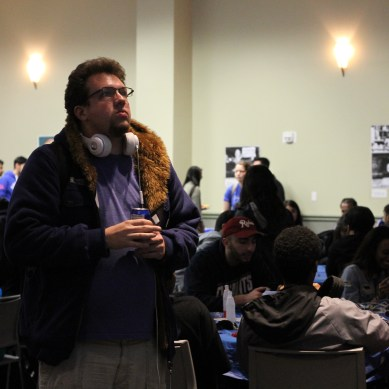 Students react to election coverage during watch party