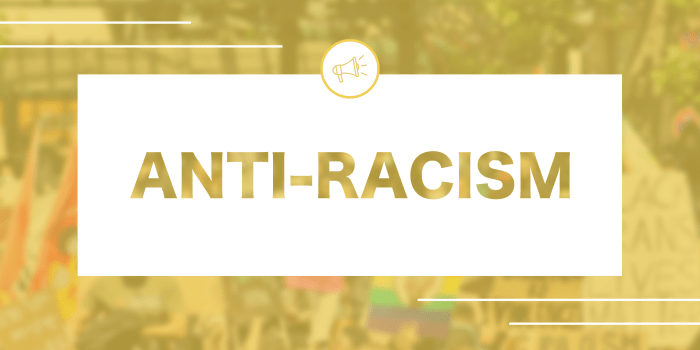 """Image of a protest with a yellow colour overlay. White box with text that reads """"Anti-Racism"""" with an icon of a megaphone above."""