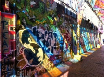 Graffiti Alley off of Central Square combines the permanent, two alley walls and an overhead stained glass roof, with the temporary, ever-changing graffiti art.