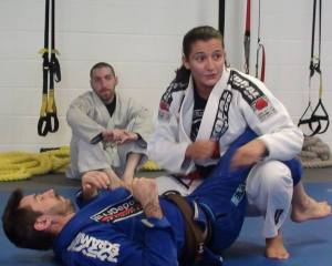 Jonathan Fader observing Luanna Alzuguir and Scott Scott Boudreau demonstrate the fine points of BJJ