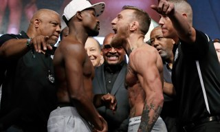 Floyd Mayweather Jr., center left, and Conor McGregor face off during a weigh-in Friday, Aug. 25, 2017, in Las Vegas. The two are scheduled to fight in a boxing match Saturday in Las Vegas. (AP Photo/John Locher) ORG XMIT: NVJL107