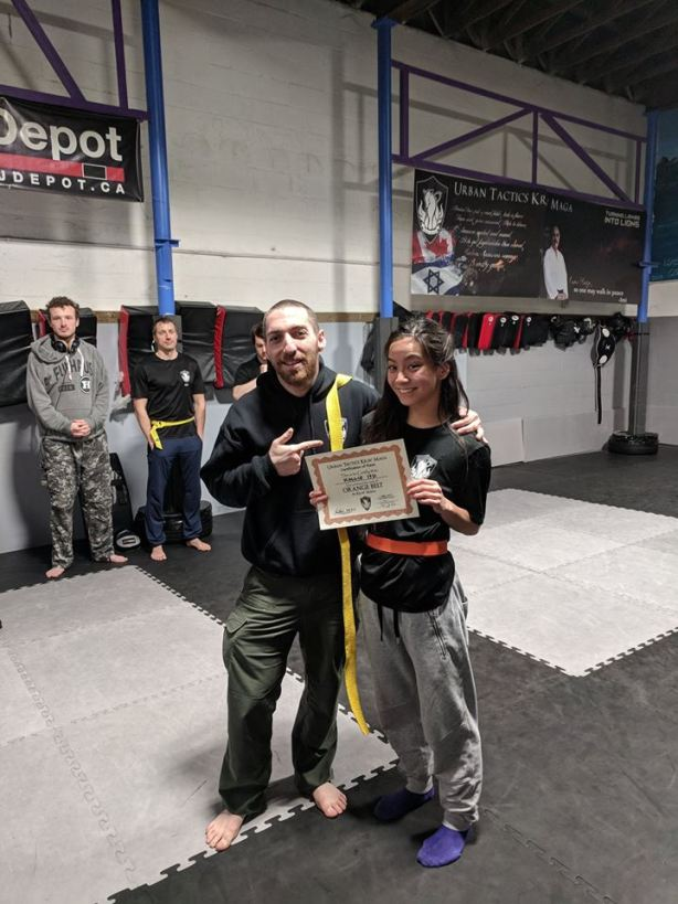 Kallie get orange belt.jpg