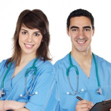 Couple of young doctors a over white background