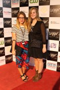 ORANGE writer and photographer Kristen Hubby (left) poses on the AFW red carpet with a fellow attendee.