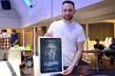 Matt Devillier, husband of director L. M. Harter, holding a poster from Galt Productions' La Llorona.